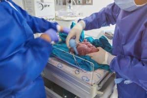 Cleaning newborn baby