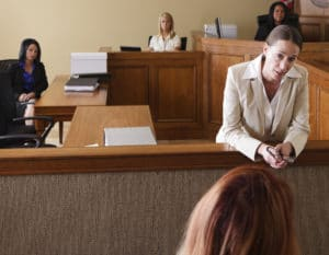 A woman lawyer addressing the jury in the courtroom.