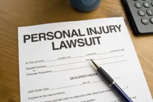 Official Court document for a Personal Injury Lawsuit on a desktop.