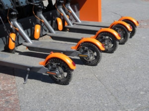Electric scooters in row on the parking lot