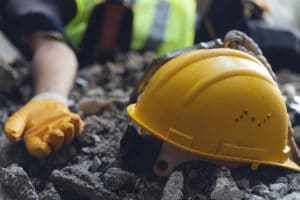 Construction worker has an accident while working on new house. Construction worker lies on the floor at the work site.