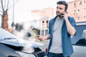 a man calling a car accident lawyer after an accident